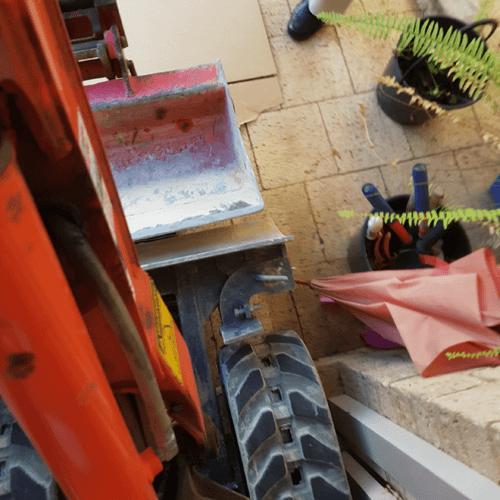 Excavator through door